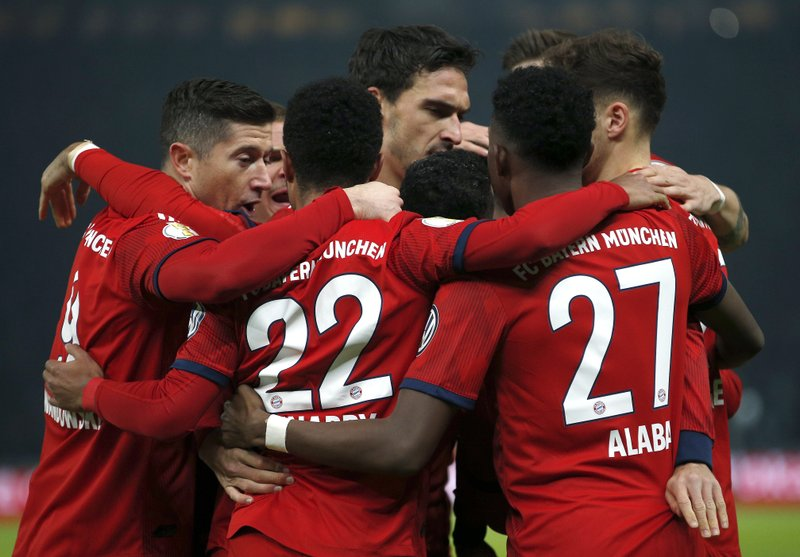 Bayern's scorer Serge Gnabry and his teammates celebrate their side's first goal during a German Soccer Cup round of sixteen match between Hertha BSC Berlin and FC Bayern Munich in Berlin, Germany, Wednesday, Feb. (AP Photo/Michael Sohn)