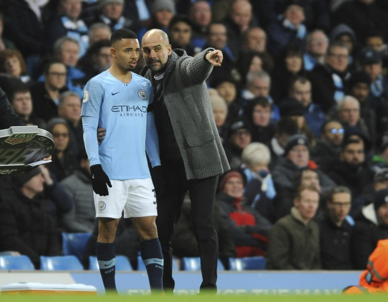 Manchester City manager Josep Guardiola gives instruction to Manchester City's Gabriel Jesus during the English Premier League soccer match between Manchester City and Chelsea at Etihad stadium in Manchester, England, Sunday, Feb. (AP Photo/Rui Vieira)