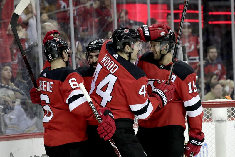 New Jersey Devils left wing Miles Wood (44) celebrates his second period goal with teammates during the second period of an NHL hockey game against the Buffalo Sabres, Sunday, Feb. (AP Photo/Julio Cortez)