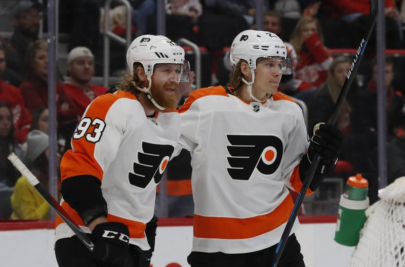 Philadelphia Flyers right wing Jakub Voracek (93) congratulates teammate left wing Oskar Lindblom after a goal during the first period of an NHL hockey game against the Detroit Red Wings, Sunday, Feb. (AP Photo/Carlos Osorio)