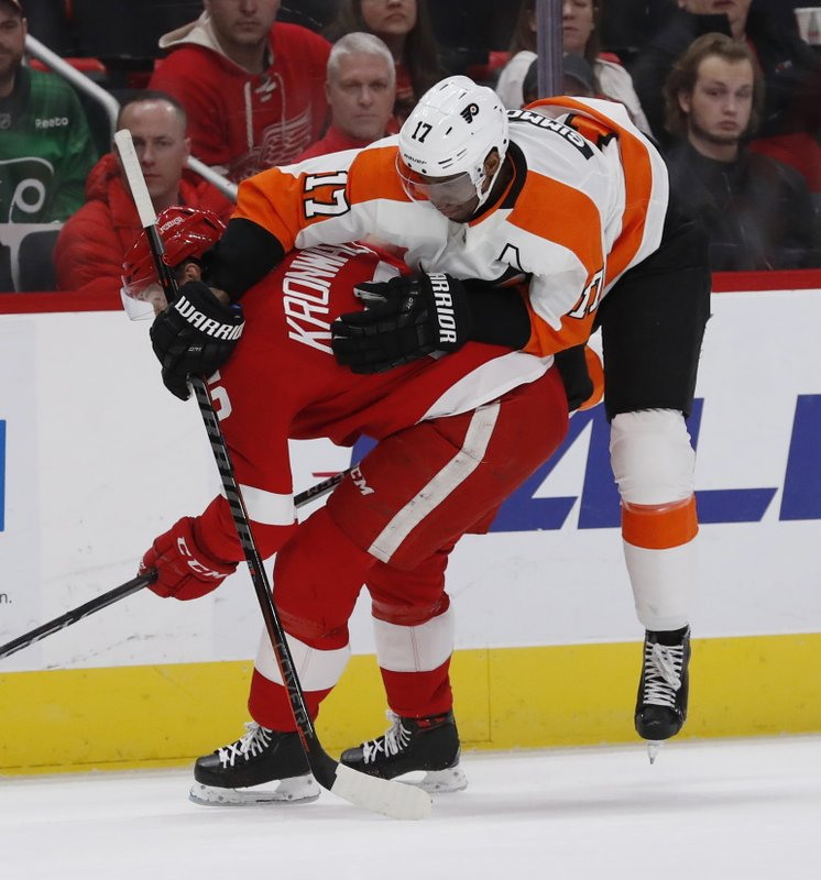 Philadelphia Flyers right wing Wayne Simmonds (17) runs into Detroit Red Wings defenseman Niklas Kronwall (55) during the first period of an NHL hockey game, Sunday, Feb. (AP Photo/Carlos Osorio)