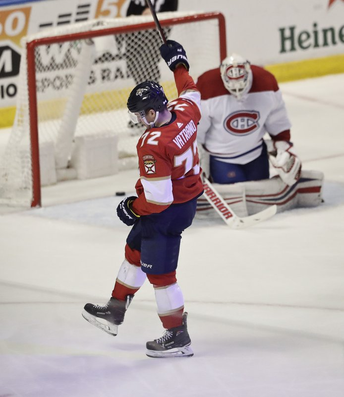 Florida Panthers center Frank Vatrano celebrates after scoring against Montreal Canadiens goaltender Antti Niemi during the first period of an NHL hockey game against the, Sunday, Feb. (AP Photo/Brynn Anderson)