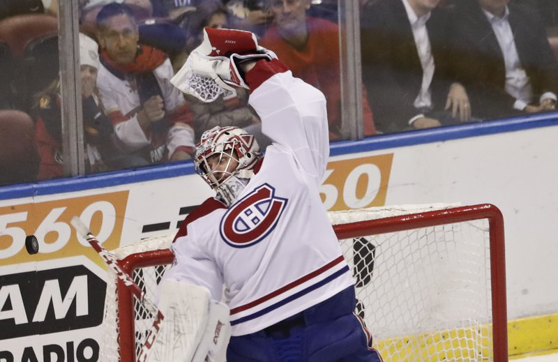 Montreal Canadiens goaltender Carey Price stretches to catch the puck flying in the air during the first period of an NHL hockey game against the Florida Panthers on Sunday, Feb. (AP Photo/Brynn Anderson)