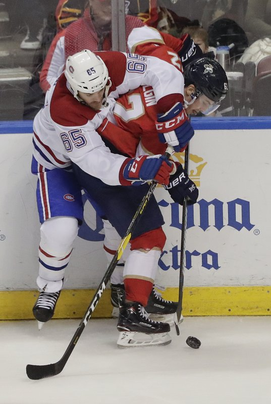 Montreal Canadiens right wing Andrew Shaw and Florida Panthers center Denis Malgin battle for the puck during the second period of an NHL hockey game on Sunday, Feb. (AP Photo/Brynn Anderson)