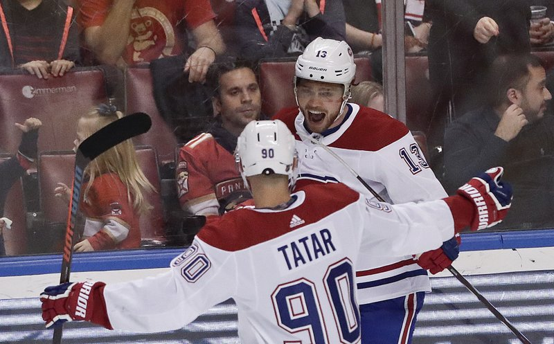Montreal Canadiens center Max Domi, right, celebrates with left wing Tomas Tatar after Domi scored during the first period of an NHL hockey game against the Florida Panthers on Sunday, Feb. (AP Photo/Brynn Anderson)