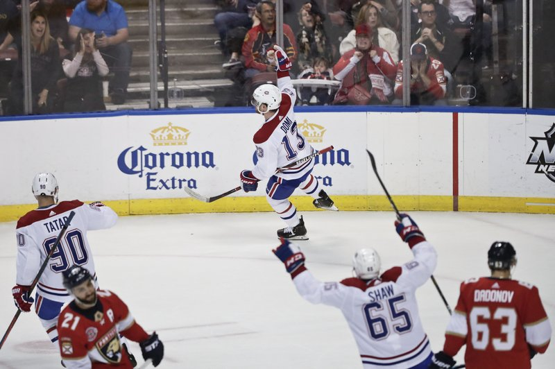 Montreal Canadiens center Max Domi celebrates after scoring during the first period of an NHL hockey game against the Florida Panthers, Sunday, Feb. (AP Photo/Brynn Anderson)