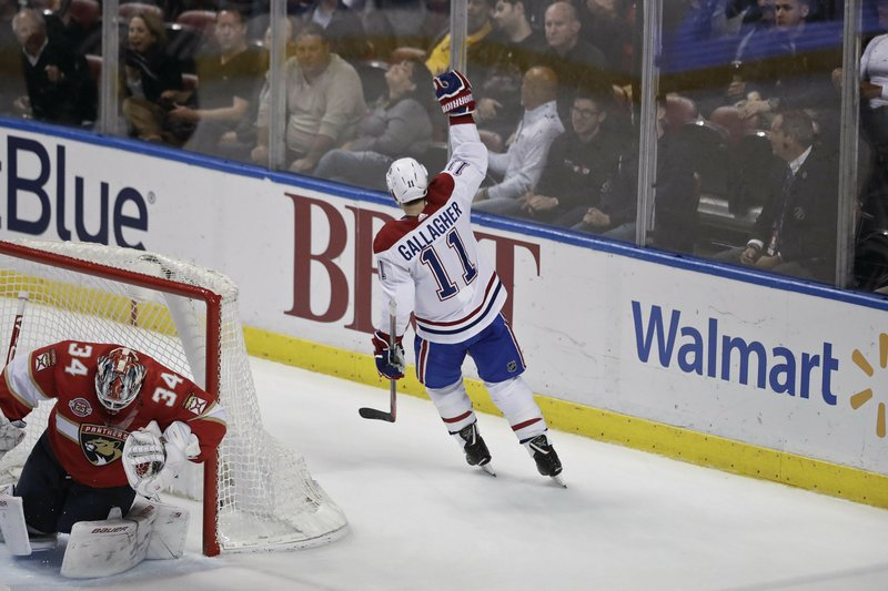 Montreal Canadiens right wing Brendan Gallagher celebrates after scoring against Florida Panthers goaltender James Reimer during the first period of an NHL hockey game on Sunday, Feb. (AP Photo/Brynn Anderson)