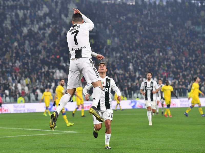 Juventus' Cristiano Ronaldo, left, celebrates with his teammate Paulo Dybala after scoring during the Serie A soccer match between Juventus and Frosinone at the Allianz Stadium in Turin, Italy,  Friday, Feb. (Alessandro Di Marco/ANSA via AP)