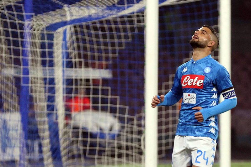 Napoli's Lorenzo Insigne rena its after missing a scoring chance during the Serie A soccer match between Napoli and Torino at the San Paolo stadium in Naples, Italy, Sunday, Feb. (Cesare Abbate/ANSA via AP)