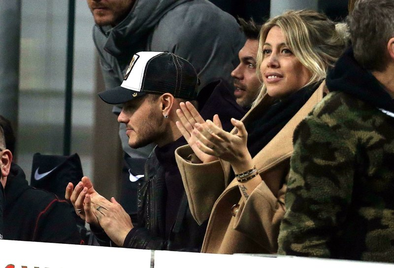Inter Milan's Mauro Icardi and his wife Wanda Nara sit in the stands during the Serie A soccer match between Inter and Sampdoria at Giuseppe Meazza stadium in Milan, Sunday, Feb. (Matteo Bazzi/ANSA via AP)