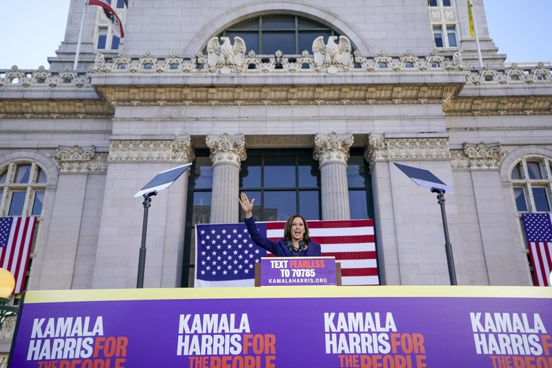 FILE - In this Jan, 27, 2019, file photo, Sen. Kamala Harris, D- Calif., waves to the crowd as she formally launches her presidential campaign at a rally in her hometown of Oakland, Calif. (AP Photo/Tony Avelar, File)