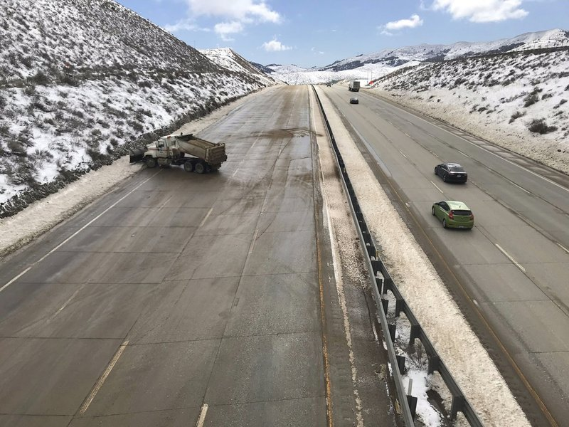 In this Feb. 18, 2019 photo released by the California Highway Patrol, CHP Central Division shows crews clearing the last of the ice, before the Northbound Interstate 5 is about to open to traffic over Grapevine, Calif. (CHP Division via AP)