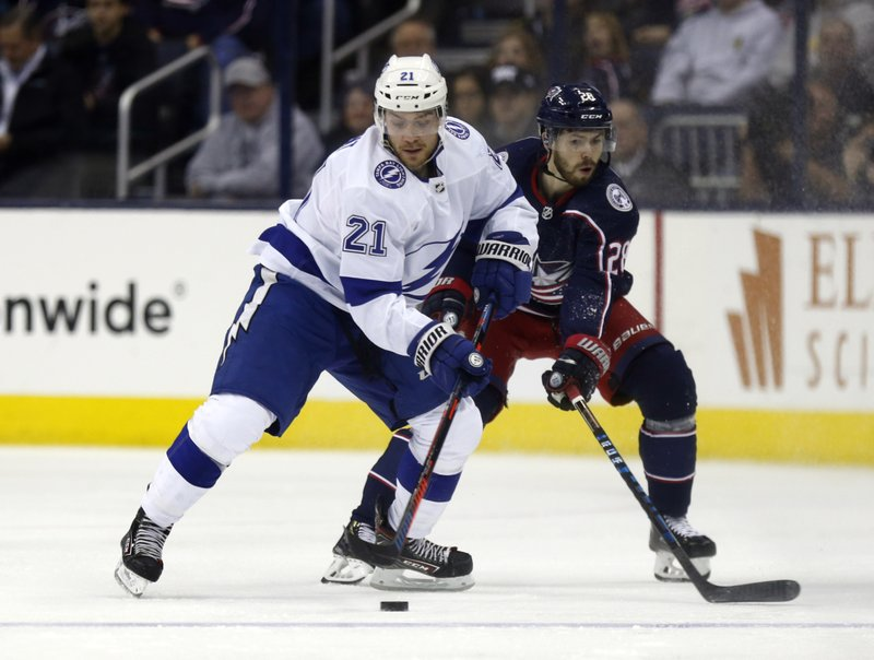 Tampa Bay Lightning defenseman Brayden Point, left, works against Columbus Blue Jackets forward Oliver Bjorkstrand, of Denmark, during the second period of an NHL hockey game in Columbus, Ohio, Monday, Feb. (AP Photo/Paul Vernon)