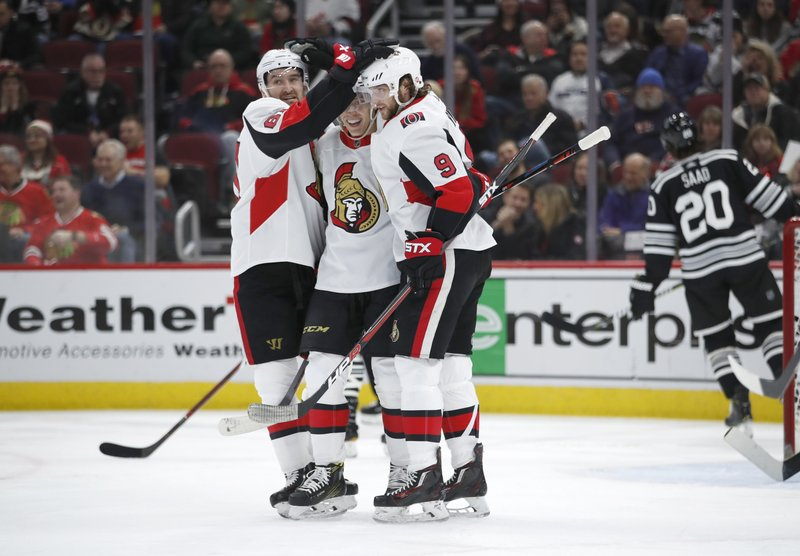 Ottawa Senators right wing Bobby Ryan (9) celebrates with teammates after his goal against the Chicago Blackhawks during the first period of an NHL hockey game Monday, Feb. (AP Photo/Jeff Haynes)