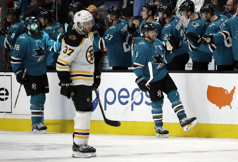 San Jose Sharks' Joe Pavelski (8) is congratulated after scoring a goal against the Boston Bruins during the second period of an NHL hockey game Monday, Feb. (AP Photo/Ben Margot)