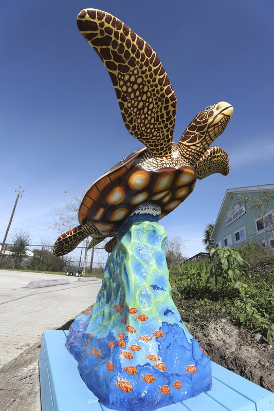 In this Wednesday, Feb. 13, 2019 photo, a sea turtle statue is displayed in front of the Campeche Cove Animal and Bird Hospital in Galveston, Texas. (Kelsey Walling/The Galveston County Daily News via AP)