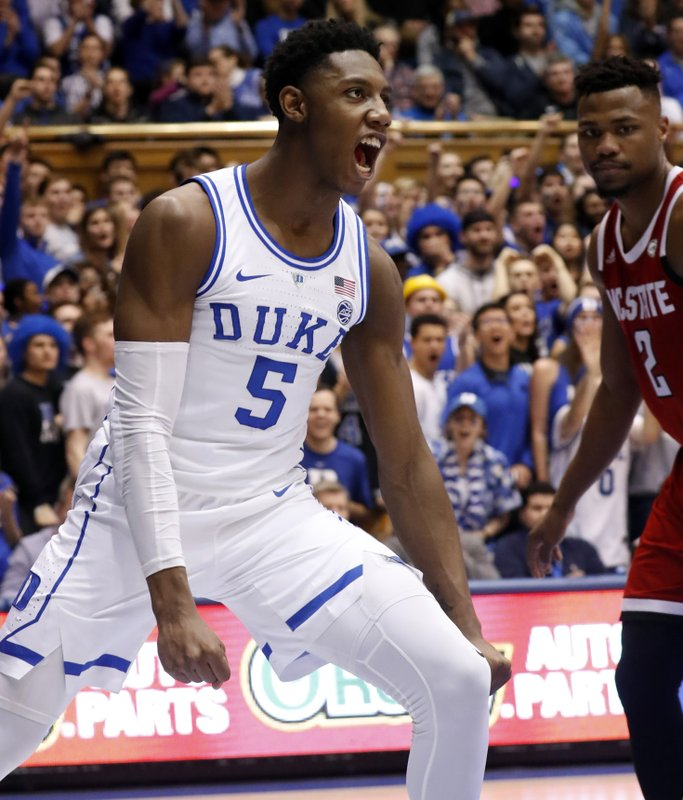 Duke's RJ Barrett (5) celebrates after a score while North Carolina State's Torin Dorn (2) looks on during the second half of an NCAA college basketball game in Durham, N. (AP Photo/Chris Seward)