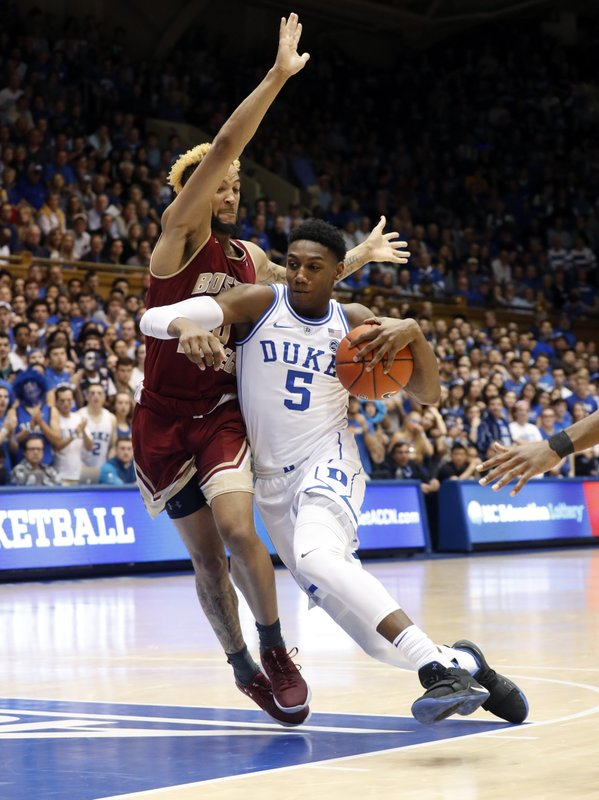 Duke's RJ Barrett (5) is defended by Boston College's Ky Bowman (0) during the second half of an NCAA college basketball game against Duke in Durham, N. (AP Photo/Chris Seward)