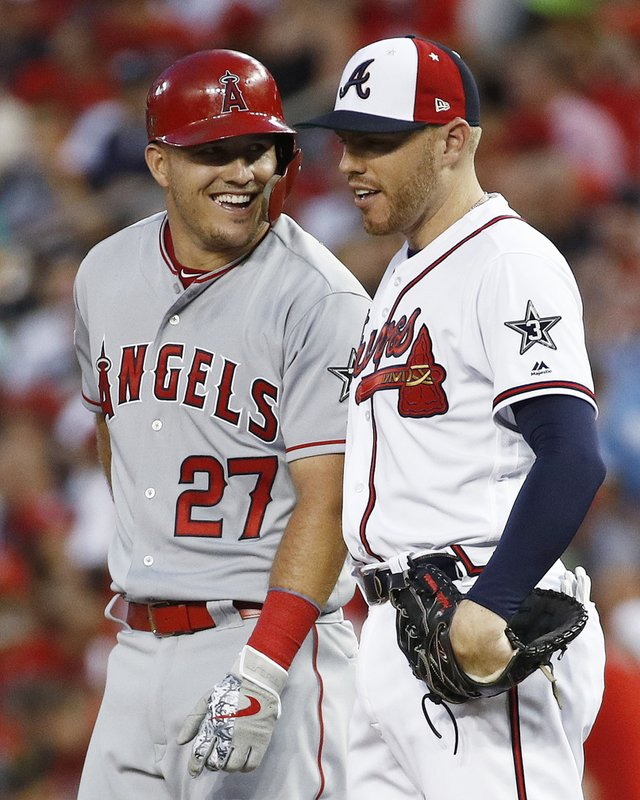 FILE - In this July 17, 2018, file photo, Los Angeles Angels of Anaheim outfielder Mike Trout (27) talks with Atlanta Braves first baseman Freddie Freeman (5) during the Major League Baseball All-star Game, in Washington. (AP Photo/Patrick Semansky, File)