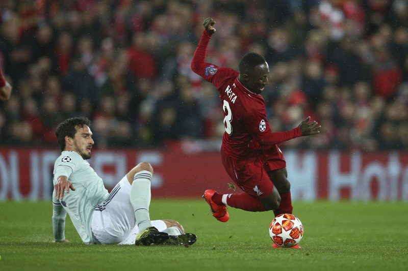 Bayern defender Mats Hummels, left, competes for the ball with Liverpool's Naby Keita during the Champions League round of 16 first leg soccer match between Liverpool and Bayern Munich at Anfield stadium in Liverpool, England, Tuesday, Feb. (AP Photo/Dave Thompson)