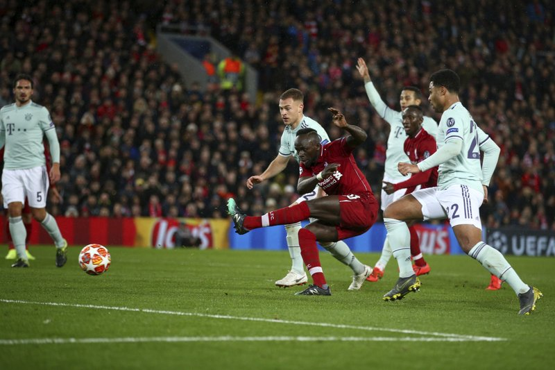 Liverpool's Sadio Mane, center, misses a chance to score during the Champions League round of 16 first leg soccer match between Liverpool and Bayern Munich at Anfield stadium in Liverpool, England, Tuesday, Feb. (AP Photo/Dave Thompson)