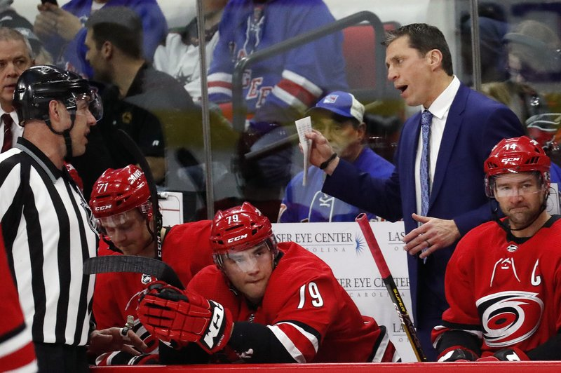 Carolina Hurricanes' head coach Rod Brind'Amour talks with an official during a break in the first period of an NHL hockey game against the New York Rangers in Raleigh, N. (AP Photo/Chris Seward)