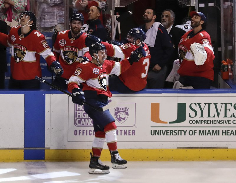 Florida Panthers center Jayce Hawryluk celebrates after scoring during the third period of the team's NHL hockey game against the Buffalo Sabres on Tuesday, Feb. (AP Photo/Brynn Anderson)