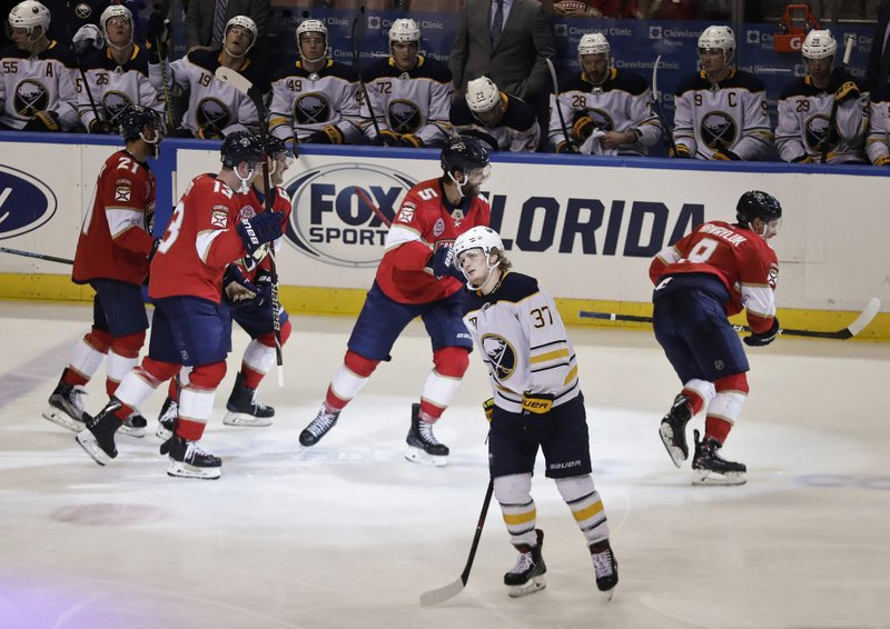 Buffalo Sabres center Casey Mittelstadt reacts to a goal by Florida Panthers left wing Jonathan Huberdeau, not seen, during the third period of an NHL hockey game Tuesday, Feb. (AP Photo/Brynn Anderson)