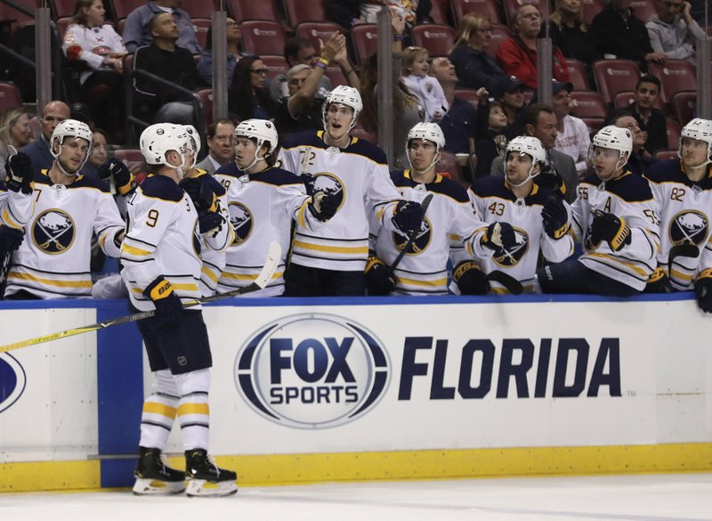 Buffalo Sabres center Jack Eichel is congratulated after scoring during the second period of the team's NHL hockey game against the Florida Panthers on Tuesday, Feb. (AP Photo/Brynn Anderson)