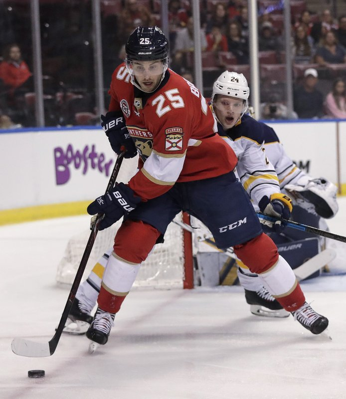 Florida Panthers center Derick Brassard, front, is defended by Buffalo Sabres defenseman Lawrence Pilut during the first period of an NHL hockey game Tuesday, Feb. (AP Photo/Brynn Anderson)