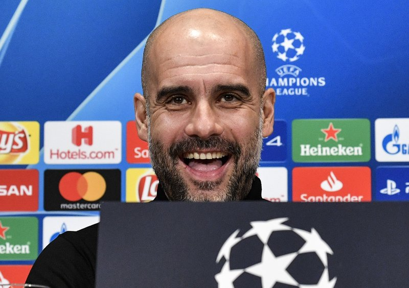 Manchester City manager Pep Guardiola smiles to the media during a press conference prior the Champions League round of 16, first leg, soccer match between FC Schalke 04 and Manchester City in Essen, Germany, Tuesday, Feb. (AP Photo/Martin Meissner)