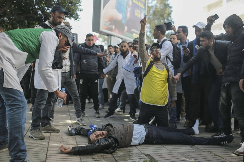 An injured protesting teacher is tended to by fellow protesters after security forces used water cannons and batons to disperse a demonstration in Rabat, Morocco, Wednesday, Feb. ($454) a month. (AP Photo/Mosa'ab Elshamy)