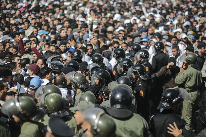 Security forces stand guard as they attempt to disperse a protest by teachers in Rabat, Morocco, Wednesday, Feb. (AP Photo/Mosa'ab Elshamy)
