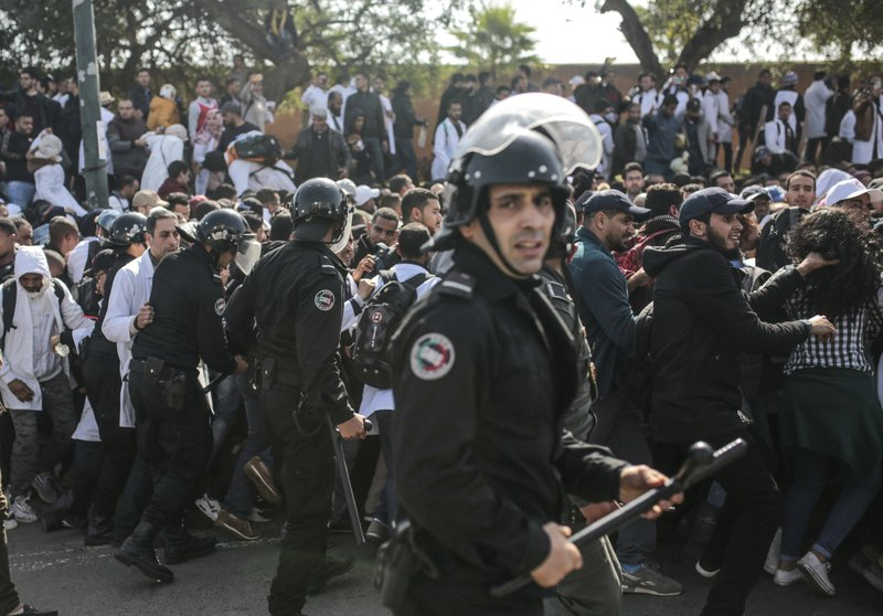 Security forces attempt to control protesting teachers during a demonstration in Rabat, Morocco, Wednesday, Feb. (AP Photo/Mosa'ab Elshamy)