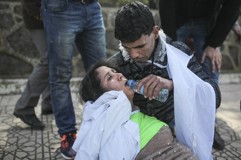An injured protesting teacher is tended to by colleagues after clashes with security forces, during a demonstration in Rabat, Morocco, Wednesday, Feb. (AP Photo/Mosa'ab Elshamy)