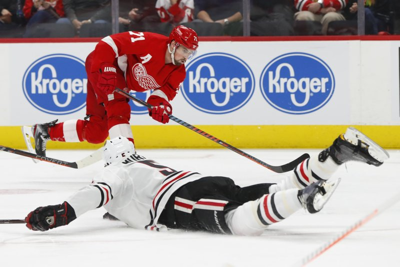 Chicago Blackhawks defenseman Connor Murphy (5) blocks a Detroit Red Wings center Dylan Larkin (71) shot in the second period of an NHL hockey game Wednesday, Feb. (AP Photo/Paul Sancya)