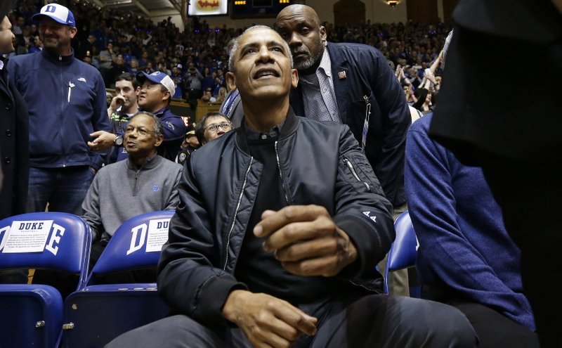 Former President Barack Obama joins fans during an NCAA college basketball game between Duke and North Carolina in Durham, N. (AP Photo/Gerry Broome)