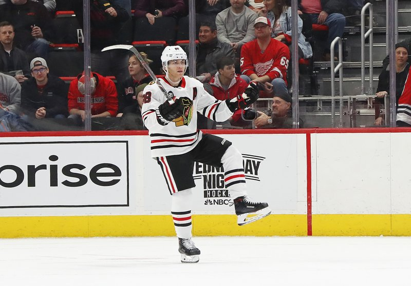 Chicago Blackhawks right wing Patrick Kane (88) celebrates his goal in overtime of an NHL hockey game against the Detroit Red Wings, Wednesday, Feb. (AP Photo/Paul Sancya)