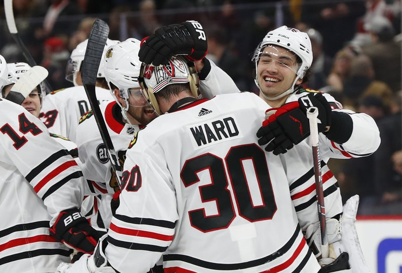Chicago Blackhawks goaltender Cam Ward (30) celebrates after beating the Detroit Red Wings 5-4 in overtime after an NHL hockey game Wednesday, Feb. (AP Photo/Paul Sancya)