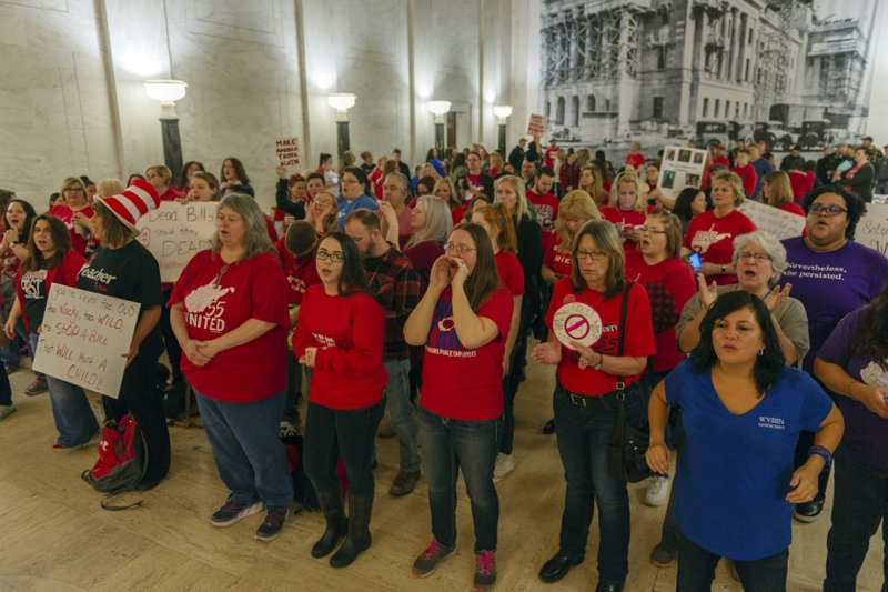 CORRECTS DAY OF WEEK TO WEDNESDAY - Teachers and school personnel, on the second day of a statewide strike, demonstrate outside the House of Delegates chamber, Wednesday, Feb. (Craig Hudson/Charleston Gazette-Mail via AP)