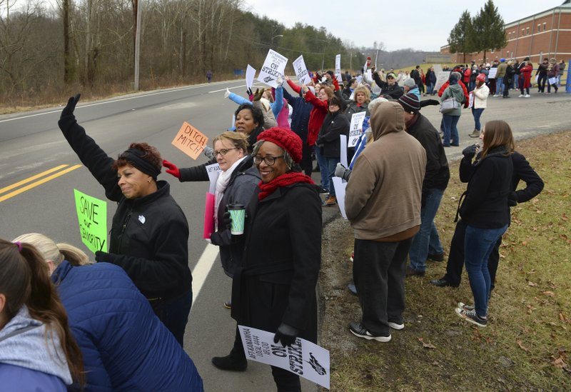 West Virginia teachers gathered at Capital High School in Charleston, WV. early Tuesday, Feb. 19, 2019, morning to protest the Omnibus Bill that is moving through the Legislature. (Kenny Kemp/Charleston Gazette-Mail via AP)
