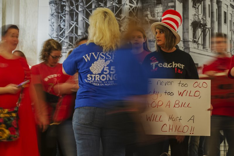 Teachers and school personnel demonstrate outside the House of Delegates chamber at the West Virginia State Capitol in Charleston, W. (Craig Hudson/Charleston Gazette-Mail via AP)