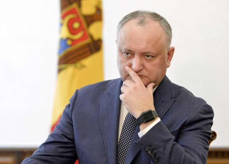 Moldova's President Igor Dodon listens to a question during an interview with the Associated Press in Chisinau, Moldova, Thursday, Feb. (AP Photo/Andreea Alexandru)