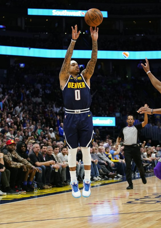 FILE - In this Feb. 13, 2019, file photo, Denver Nuggets guard Isaiah Thomas (0) shoots a three point basket against the Sacramento Kings during the second half of an NBA basketball game, in Denver. (AP Photo/Jack Dempsey, File)