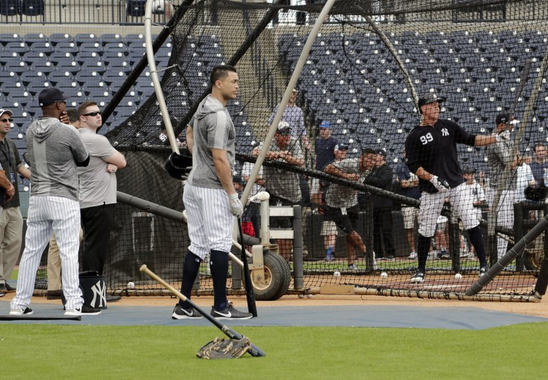 New York Yankees' Giancarlo Stanton, left, watches as Aaron Judge bats at the Yankees spring training baseball facility, Thursday, Feb. (AP Photo/Lynne Sladky)