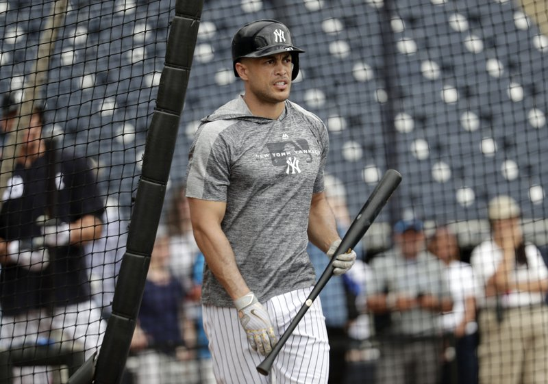 New York Yankees' Giancarlo Stanton walks from the batting cage at the Yankees spring training baseball facility, Thursday, Feb. (AP Photo/Lynne Sladky)