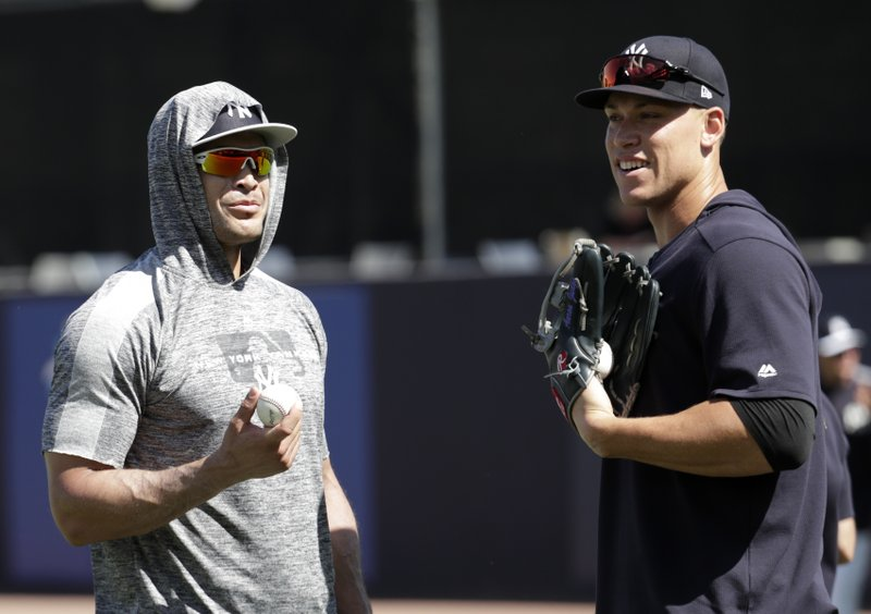 New York Yankees' Giancarlo Stanton, left, and Aaron Judge do drills at the Yankees spring training baseball facility, Thursday, Feb. (AP Photo/Lynne Sladky)