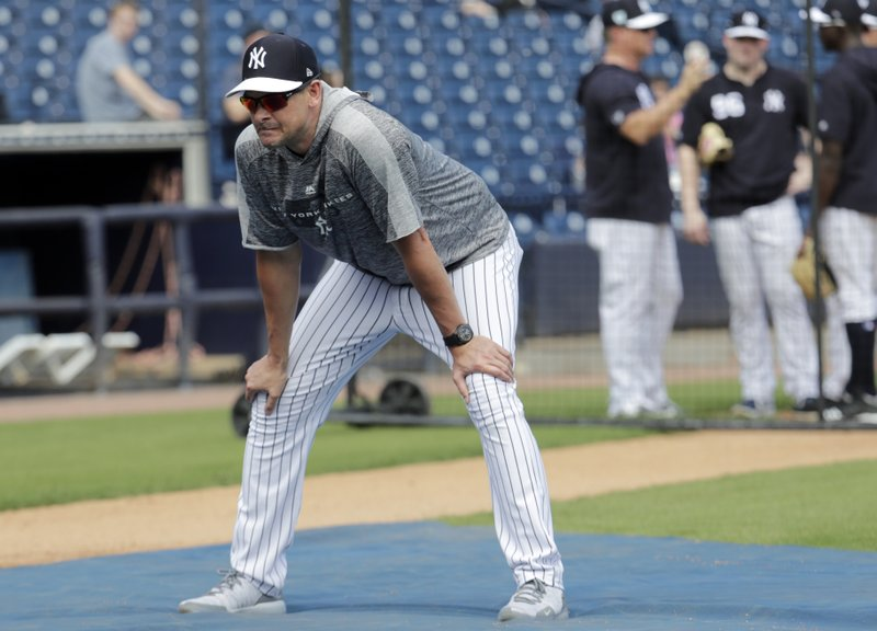 New York Yankees manager Aaron Boone watches batting practice at the Yankees spring training baseball facility, Thursday, Feb. (AP Photo/Lynne Sladky)