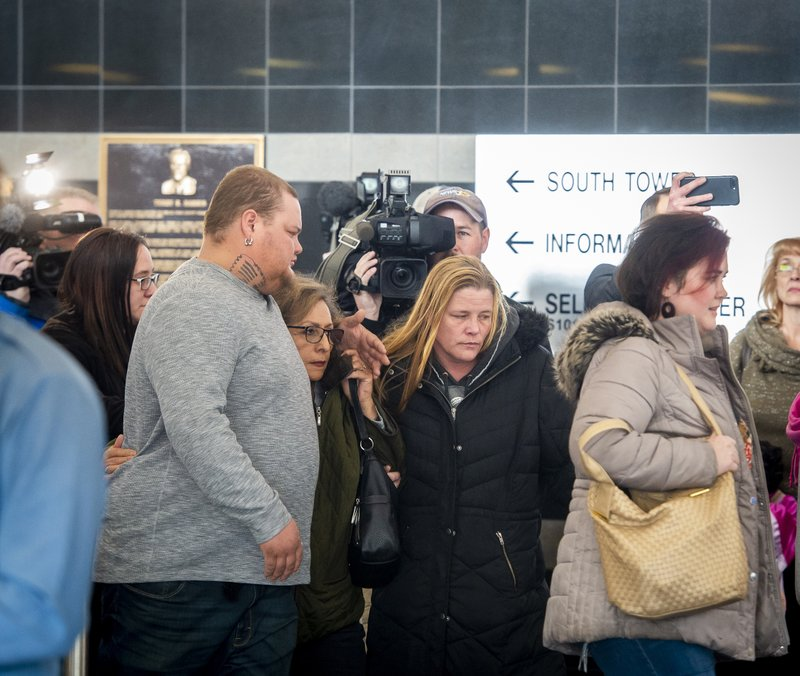 Several members of James Alan Neal's family leave El Paso County's Terry R. Harris Judicial Complex on Thursday, Feb. (Dougal Brownlie/The Gazette via AP)