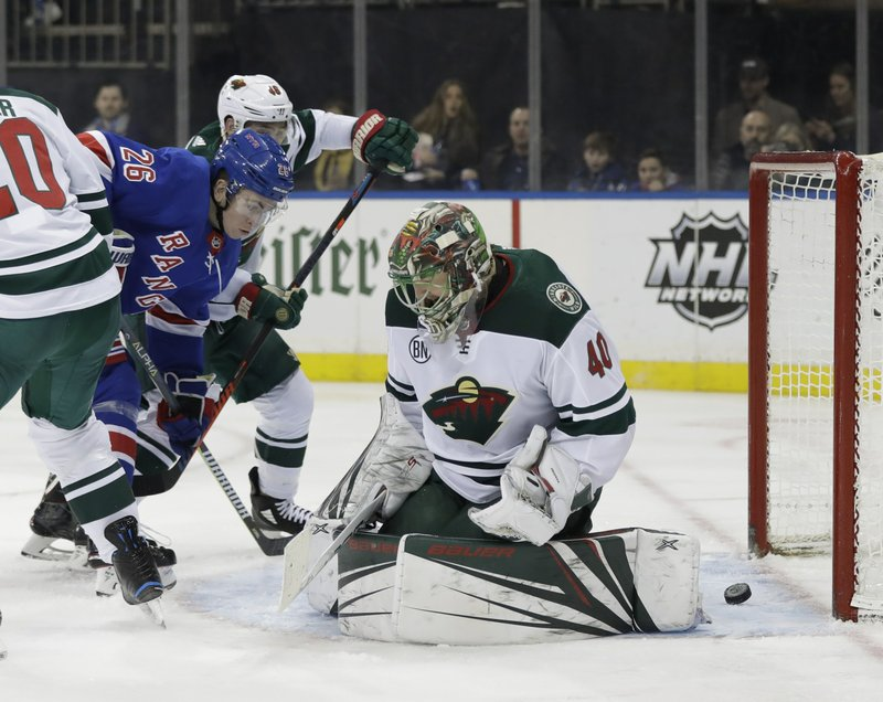 New York Rangers' Jimmy Vesey (26) watches as a shot by teammate Pavel Buchnevich gets past Minnesota Wild goaltender Devan Dubnyk (40) for a goal during the second period of an NHL hockey game Thursday, Feb. (AP Photo/Frank Franklin II)
